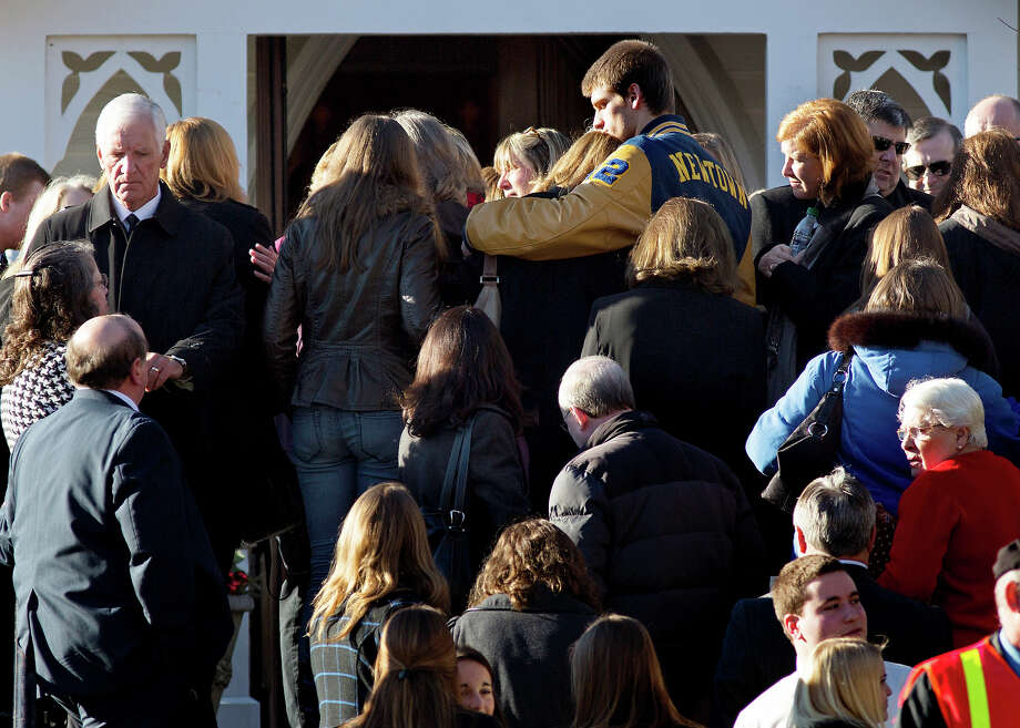 Mourners gather before services for teacher Anne Marie Murphy at the St. Mary Of The Assumption Church in Katonah, N.Y. Thursday, Dec. 20, 2012.  Murphy was killed when gunman, Adam Lanza, walked into Sandy Hook Elementary School in Newtown, Conn., Dec. 14, and opened fire, killing 26, including 20 children, before killing himself. Photo: AP