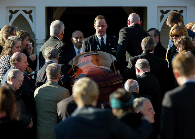 The casket of teacher Anne Marie Murphy is lifted into St. Mary Of The Assumption Church in Katonah, N.Y. Thursday, Dec. 20, 2012. Murphy was killed when gunman, Adam Lanza, walked into Sandy Hook Elementary School in Newtown, Conn., Dec. 14, and opened fire, killing 26, including 20 children, before killing himself. Photo: AP