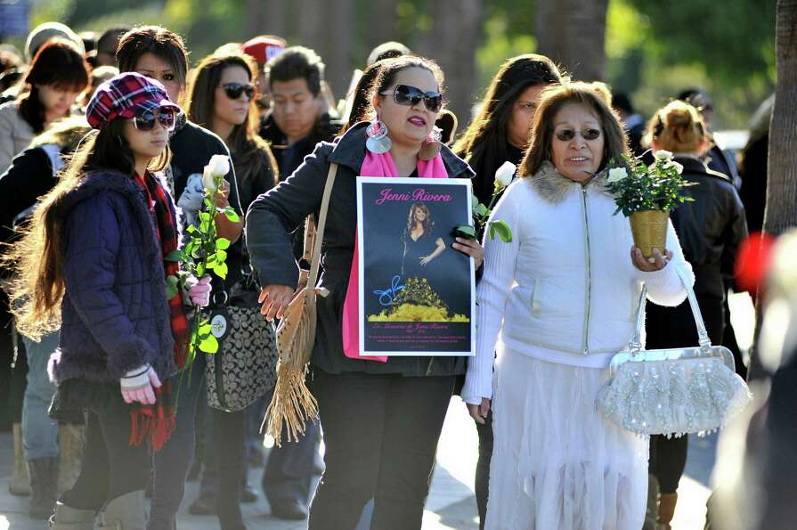 Fans gather to mourn the loss of singer Jenni Rivera at her memorial ceremony at Gibson Amphitheatre