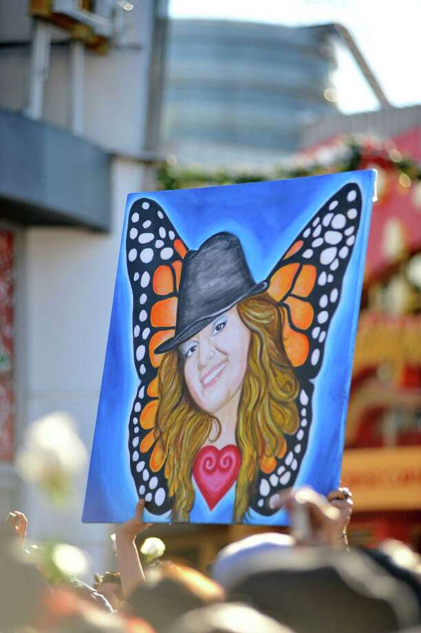 Fans gather to mourn the loss of singer Jenni Rivera at her memorial ceremony at Gibson Amphitheatre on December 19, 2012 in Universal City, California. Photo: Toby Canham, Getty Images / 2012 Getty Images