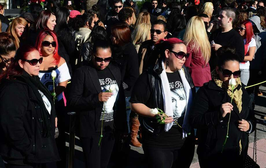 "Fans of the late Mexican-American singer Jenni Rivera wait in line with their tickets to attend the memorial service at the Gibson Amphitheater in Universal City on December 19, 2012 in California. The service, billed by the Rivera family as a ""Celestial Graduation,'' was broadcast live and watched by her many fans off a big screen at a Universal CityWalk plaza. Photo: FREDERIC J. BROWN, AFP/Getty Images / AFP"