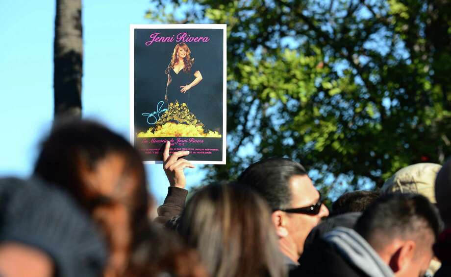 "Fans of the late Mexican-American singer Jenni Rivera wait to attend the memorial service at the Gibson Amphitheater in Universal City on December 19, 2012 in California. The service, billed by the Rivera family as a ""Celestial Graduation,'' was broadcast live and watched by her many fans off a big screen at a Universal CityWalk plaza.  Photo: FREDERIC J. BROWN, AFP/Getty Images / AFP"