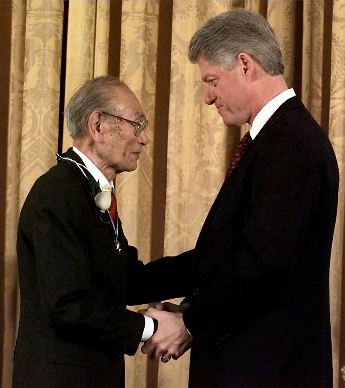 ** FILE ** President Clinton, right, presents Fred Korematsu with a Presidential Medal of Freedom during a ceremony at the White House in Washington in this Jan. 15, 1998 file photo. Korematsu, who unsuccessfully fought the order to be sent to a Japenese American internment camp during World War II, died Wednesday, March 30, 2005. He was 86. Korematsu died of respiratory illness at his daughter's home in Larkspur, said his attorney Dale Minami. (AP Photo/Dennis Cook, file) Ran on: 04-01-2005 Fred Korematsu receives the Presidential Medal of Freedom from President Bill Clinton. Ran on: 04-01-2005 Photo caption Dummy text goes here. Dummy text goes here. Dummy text goes here. Dummy text goes here. Dummy text goes here. Dummy text goes here. Dummy text goes here. Dummy text goes here. Ran on: 04-01-2005 Photo caption Dummy text goes here. Dummy text goes here. Dummy text goes here. Dummy text goes here. Dummy text goes here. Dummy text goes here. Dummy text goes here. Dummy text goes here. Ran on: 04-01-2005 Photo caption Dummy text goes here. Dummy text goes here. Dummy text goes here. Dummy text goes here. Dummy text goes here. Dummy text goes here. Dummy text goes here. Dummy text goes here. Ran on: 01-29-2011 Fred Korematsu (left) receives the Presidential Medal of Freedom from President Bill Clinton.
