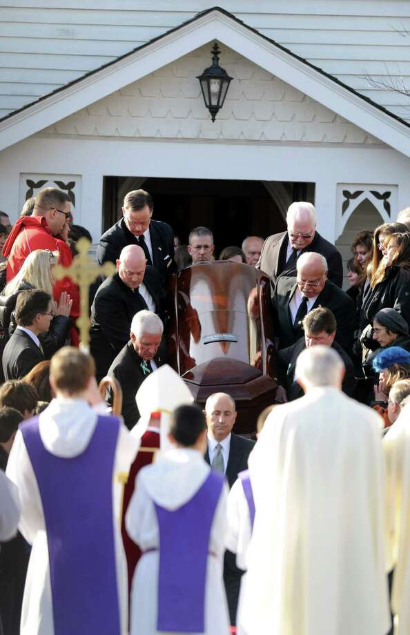 Pallbearers carry Anne Marie Murphy's casket from St. Mary of the Assumption Roman Catholic Church in Katonah, NY, to a hearse after the funeral mass for the Sandy Hook Elementary School Special Education teacher on Thursday, December 20, 2012. The funeral's homily was given by Cardinal Timothy Dolan. Photo: Lindsay Niegelberg, Niegelberg / Stamford Advocate