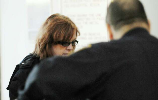 Virginia DeCapria of Charlton makes her way through the security checkpoint on Thursday, Dec. 20. 2012, as she enters Saratoga County Court for her arraignment on charges she failed to pay state income taxes for the years she stole $500,000 from a Charlton Fire District. (Paul Buckowski / Times Union) Photo: Paul Buckowski  / 00020538A
