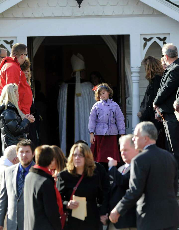 A young mourner exits St. Mary of the Assumption Roman Catholic Church in Katonah, NY, after the funeral of Sandy Hook Elementary School Special Education teacher Anne Marie Murphy on Thursday, December 20, 2012. Photo: Lindsay Niegelberg, Niegelberg / Stamford Advocate