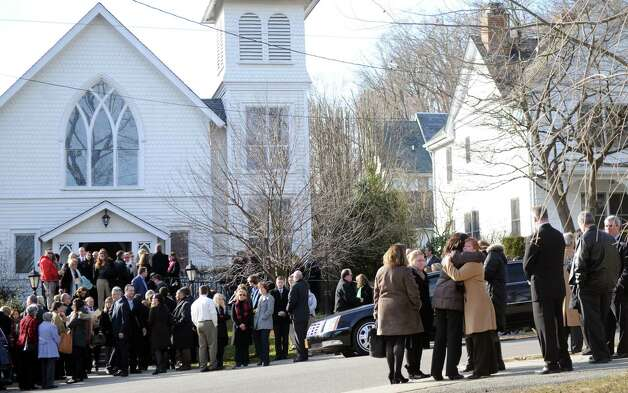 Mourners exit St. Mary of the Assumption Roman Catholic Church in Katonah, NY, after the funeral of Sandy Hook Elementary School Special Education teacher Anne Marie Murphy on Thursday, December 20, 2012. Photo: Lindsay Niegelberg, Niegelberg / Stamford Advocate