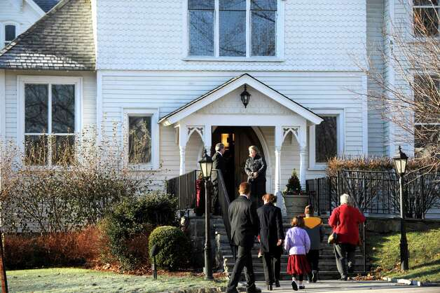 Mourners arrive at St. Mary of the Assumption Roman Catholic Church in Katonah, NY, for the funeral of Sandy Hook Elementary School Special Education teacher Anne Marie Murphy on Thursday, December 20, 2012. Photo: Lindsay Niegelberg, Niegelberg / Stamford Advocate