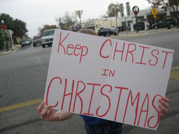 People gathered on New Braunfels' Main Plaza Wednesday in support of banners put up by the local Knights of Columbus to remind Christians of the holiday's focus. Photo: Courtesy