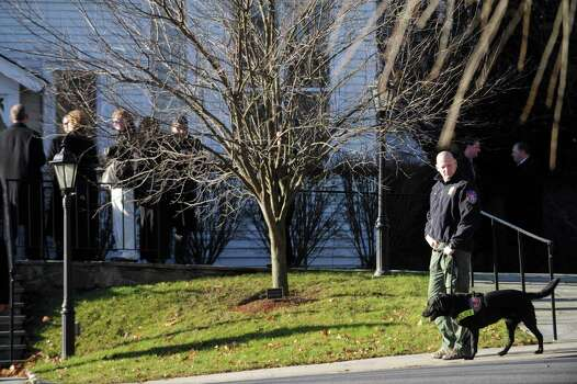 Police walk through and around St. Mary of the Assumption Roman Catholic Church in Katonah, NY, before the funeral of Sandy Hook Elementary School Special Education teacher Anne Marie Murphy on Thursday, December 20, 2012. Photo: Lindsay Niegelberg, Niegelberg / Stamford Advocate