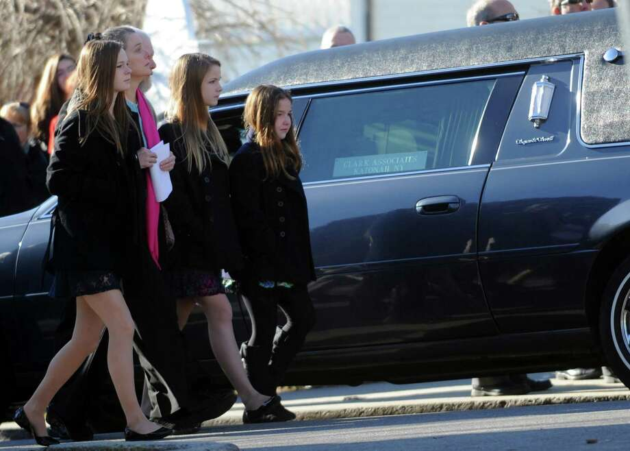 Family members arrive at St. Mary of the Assumption Roman Catholic Church in Katonah, NY, for the funeral of Sandy Hook Elementary School Special Education teacher Anne Marie Murphy on Thursday, December 20, 2012. Photo: Lindsay Niegelberg, Niegelberg / Stamford Advocate
