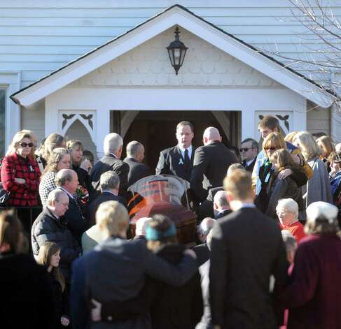 The casket of Sandy Hook Elementary School Special Education teacher Anne Marie Murphy is carried into St. Mary of the Assumption Roman Catholic Church in Katonah, NY, on Thursday, December 20, 2012. Photo: Lindsay Niegelberg, Niegelberg / Stamford Advocate