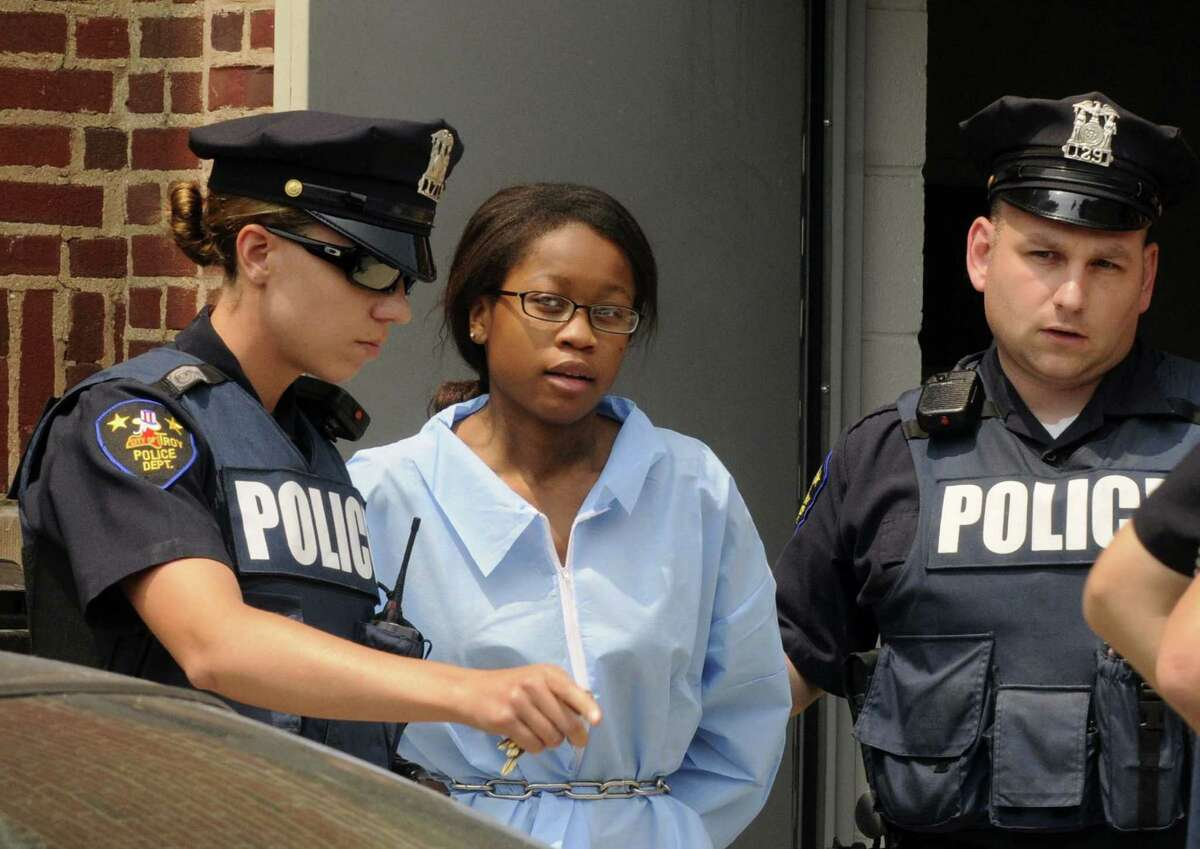 Troy Police transfer 17-year-old Trinity Copeland, who was arraigned earlier for the murder of her father Harlan Copeland, from Troy City Court in Troy NY Friday July 13, 2012. (Michael P. Farrell/Times Union)
