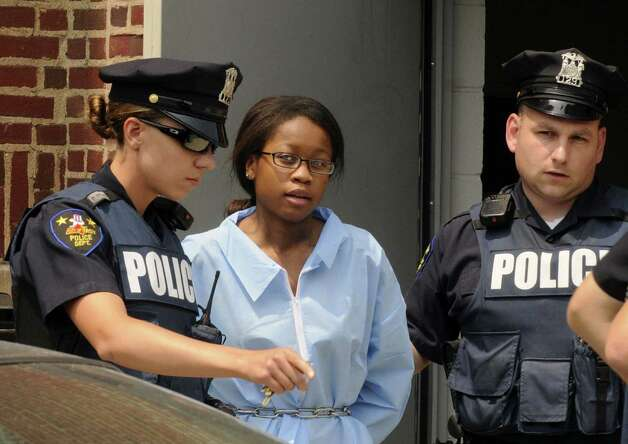 Troy Police transfer 17-year-old Trinity Copeland, who was arraigned earlier for the murder of her father Harlan Copeland, from Troy City Court in Troy NY Friday  July 13, 2012. (Michael P. Farrell/Times Union) Photo: Michael P. Farrell