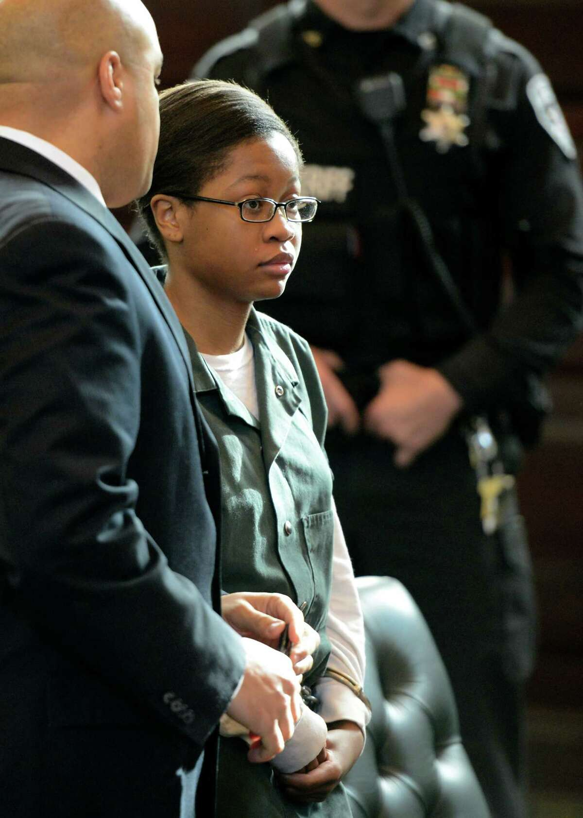 Trinity Copeland, represented by attorney Matthew Smalls, left, was arraigned on second-degree murder charges in front of Judge Andrew Ceresia at the Rensselaer County Courthouse in Troy, N.Y. Dec. 20, 2012. (Skip Dickstein/Times Union archive)
