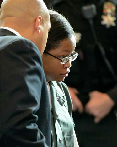 Trinity Copeland, represented by attorney Matthew Smalls, left, was arraigned on second-degree murder charges in front of Judge Andrew Ceresia at the Rensselaer County Courthouse in Troy, N.Y. Dec. 20, 2012.   (Skip Dickstein/Times Union) Photo: SKIP DICKSTEIN