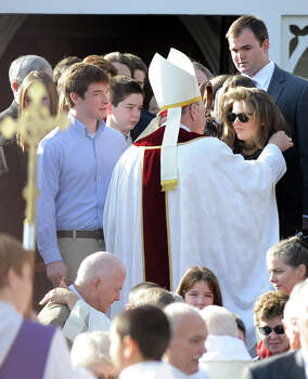 Cardinal Timothy Dolan comforts mourners as he exits St. Mary of the Assumption Roman Catholic Church in Katonah, NY, after the funeral of Sandy Hook Elementary School Special Education teacher Anne Marie Murphy on Thursday, December 20, 2012. Photo: Lindsay Niegelberg, Niegelberg / Stamford Advocate