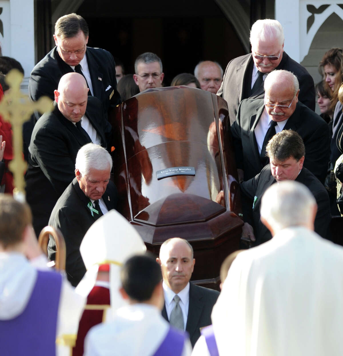 Pallbearers carry Anne Marie Murphy's casket from St. Mary of the Assumption Roman Catholic Church in Katonah, NY, to a hearse after the funeral mass for the Sandy Hook Elementary School Special Education teacher on Thursday, December 20, 2012.