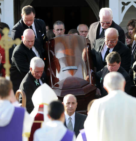 Pallbearers carry Anne Marie Murphy's casket from St. Mary of the Assumption Roman Catholic Church in Katonah, NY, to a hearse after the funeral mass for the Sandy Hook Elementary School Special Education teacher on Thursday, December 20, 2012. Photo: Lindsay Niegelberg, Niegelberg / Stamford Advocate