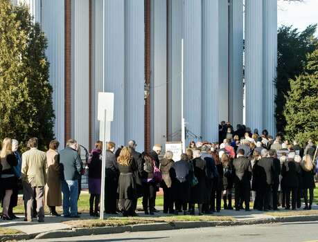 Family and friends line the sidewalk as they enter the First Congregational Church on Deer Hill Avenue in Danbury for the memorial service of Sandy Hook Elementary School teacher Lauren Rousseau. Thursday, Dec. 20, 2012 Photo: Scott Mullin