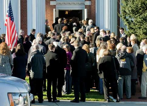Family and friends enter the First Congregational Church on Deer Hill Avenue in Danbury for the memorial service of Sandy Hook Elementary School teacher Lauren Rousseau. Thursday, Dec. 20, 2012 Photo: Scott Mullin / The News-Times Freelance