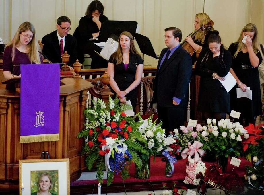 Friends of Sandy Hook Elementary School teacher Lauren Rousseau talk about fond memories of Lauren during the memorial service at the First Congregational Church on Deer Hill Avenue in Danbury. Thursday, Dec. 20, 2012 Photo: Scott Mullin