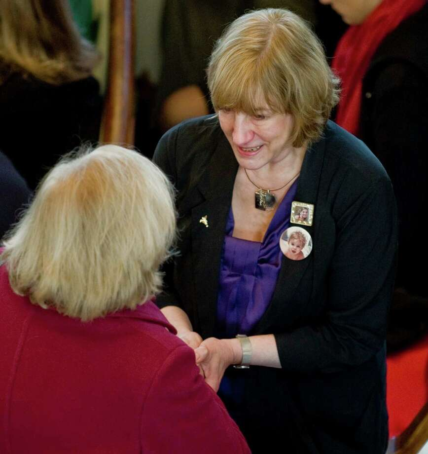 Terri Rousseau, mother of Sandy Hook Elementary School teacher Lauren Rousseau, greets family and friends prior to the start of the memorial service at the First Congregational Church on Deer Hill Avenue in Danbury. Thursday, Dec. 20, 2012 Photo: Scott Mullin
