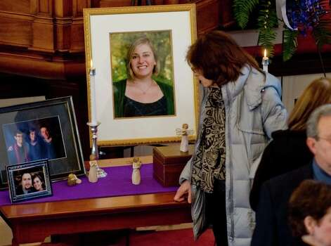 Those paying respect pass by a table of photographs prior to the beginning of the memorial service for Sandy Hook Elementary School teacher Lauren Rousseau, at the First Congregational Church on Deer Hill Avenue in Danbury. Thursday, Dec. 20, 2012 Photo: Scott Mullin / The News-Times Freelance