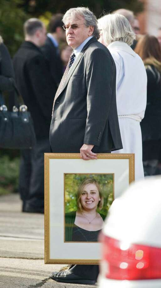 Gillis Rousseau, father of Sandy Hook Elementary School teacher Lauren Rousseau, carries a photograph of his daughter after the memorial service at the First Congregational Church on Deer Hill Avenue in Danbury. Thursday, Dec. 20, 2012 Photo: Scott Mullin / The News-Times Freelance