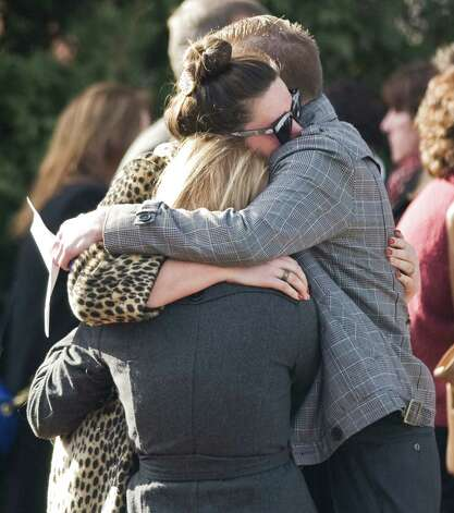 Family and friends hug each other after the memorial service for Sandy Hook Elementary School teacher Lauren Rousseau at the First Congregational Church on Deer Hill Avenue in Danbury. Thursday, Dec. 20, 2012 Photo: Scott Mullin / The News-Times Freelance