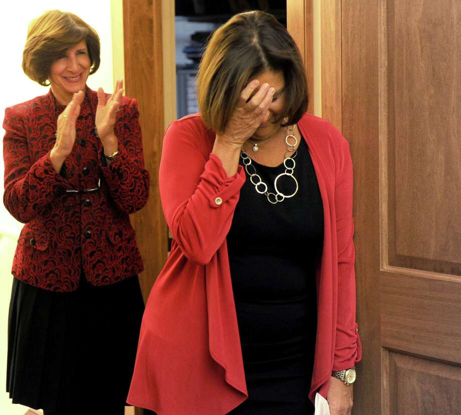 Jami Sherwood reacts as she finds out she has been named City of Stamford Citizen of the Year 2012 on Thursday, December 20, 2012. Photo: Lindsay Niegelberg, Niegelberg / Stamford Advocate