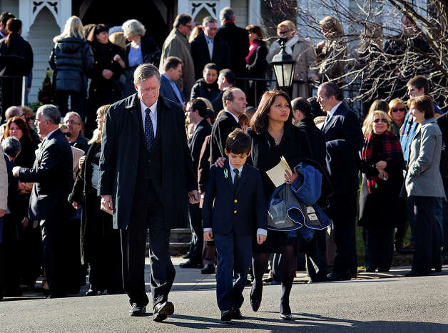 A young mourner is escorted from the funeral of teacher Anne Marie Murphy at the St. Mary Of The Assumption Church in Katonah, N.Y. Thursday, Dec. 20, 2012. Murphy was killed when Adam Lanza, walked into Sandy Hook Elementary School in Newtown, Conn., Dec. 14, and opened fire, killing 26, including 20 children, before killing himself. Photo: AP