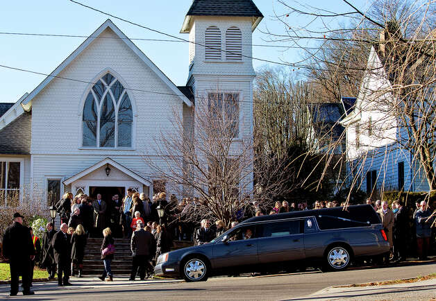 A hearse carrying teacher Anne Marie Murphy arrives at St. Mary Of The Assumption Church in Katonah, N.Y. Thursday, Dec. 20, 2012. Murphy was killed when Adam Lanza, walked into Sandy Hook Elementary School in Newtown, Conn., Dec. 14, and opened fire, killing 26, including 20 children, before killing himself. Photo: AP
