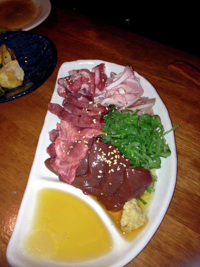 Cosentino: This is a raw pork plate. So that's liver, tongue, heart, belly and there's a piece of kidney in there ... So what happens is you also have scallion, ginger, sesame. You dip, mix, and eat.
