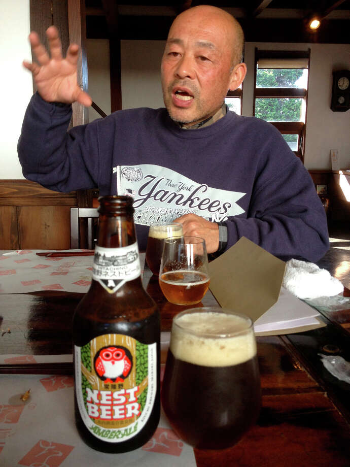 Toshiyuki Kiuchi, the owner of Hitachino Nest Beer, with an amber beer that is unavailable in the U.S.