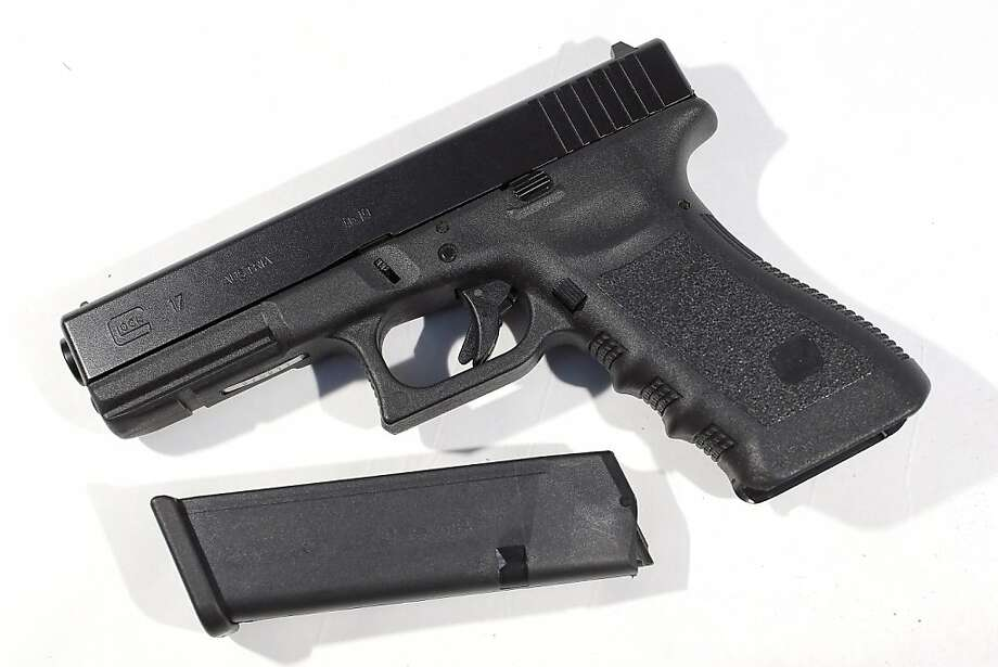 MIAMI, FL - DECEMBER 18:  In this photo illustration, a Glock pistol with a 17 round magazine is seen on December 18, 2012 in Miami, Florida. The weapon is the same type that was used during a massacre at an elementary school in Newtown, Connecticut.  Firearm sales have surged recently as speculation of stricter gun laws and a re-instatement of the assault weapons ban following the mass shooting.  (Photo illustration by Joe Raedle/Getty Images) Photo: Joe Raedle, Getty Images