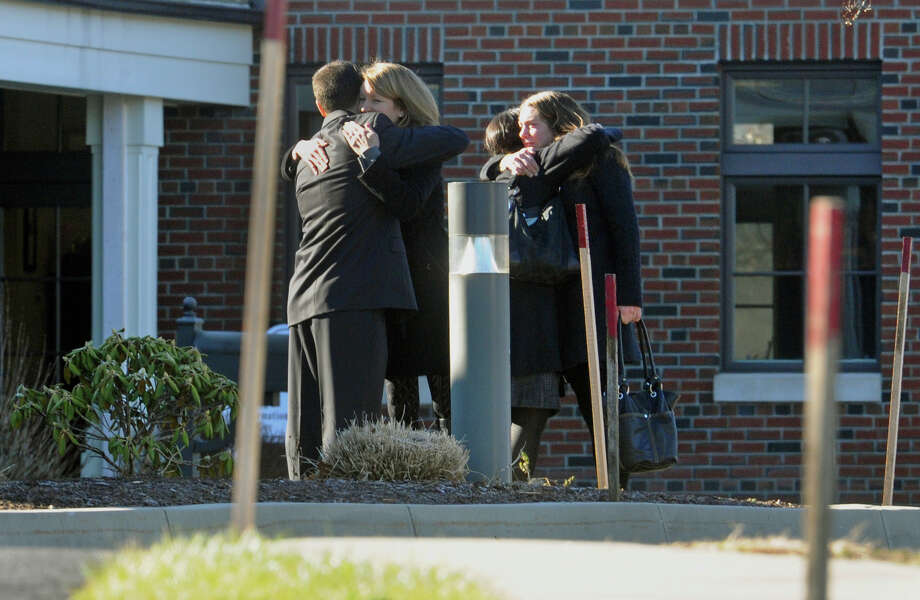 Mourners embrace as they arrive for the funeral for Sandy Hook Elementary School student Allison Wyatt which was held at Sacred Heart Roman Catholic Church in Southbury Conn. on Thursday December 20, 2012. Photo: Christian Abraham / Connecticut Post