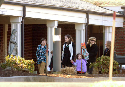 Mourners arrive for the funeral for Sandy Hook Elementary School student Allison Wyatt which was held at Sacred Heart Roman Catholic Church in Southbury Conn. on Thursday December 20, 2012. Photo: Christian Abraham / Connecticut Post