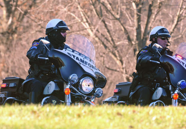 Motorcycle police from Stamford arrive for the funeral for Sandy Hook Elementary School student Allison Wyatt which was held at Sacred Heart Roman Catholic Church in Southbury Conn. on Thursday December 20, 2012. Photo: Christian Abraham / Connecticut Post