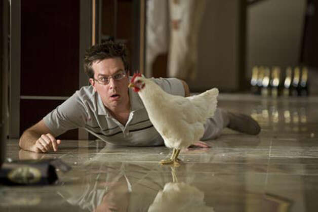 "Stu (Ed Helms) has no idea why there's a chicken in his hotel room in a scene from the film ""The Hangover."" Photo: WARNER BROS. / ©2009 Warner Bros. Entertainment Inc."