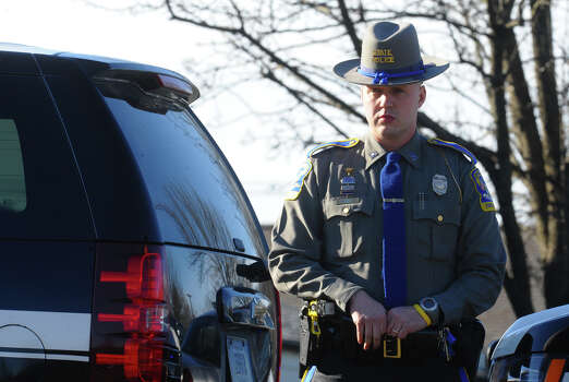 A Connecticut State police officer stands guard during the funeral for Sandy Hook Elementary School student Allison Wyatt which was held at Sacred Heart Roman Catholic Church in Southbury Conn. on Thursday December 20, 2012. Photo: Christian Abraham / Connecticut Post