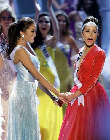 Miss USA, Olivia Culpo, right, reacts as she is announced as the new Miss Universe over first runner-up Miss Philippines, Janine Tugonon, left, during the Miss Universe competition, Wednesday, Dec. 19, 2012, in Las Vegas. (AP Photo/Julie Jacobson) Photo: Julie Jacobson
