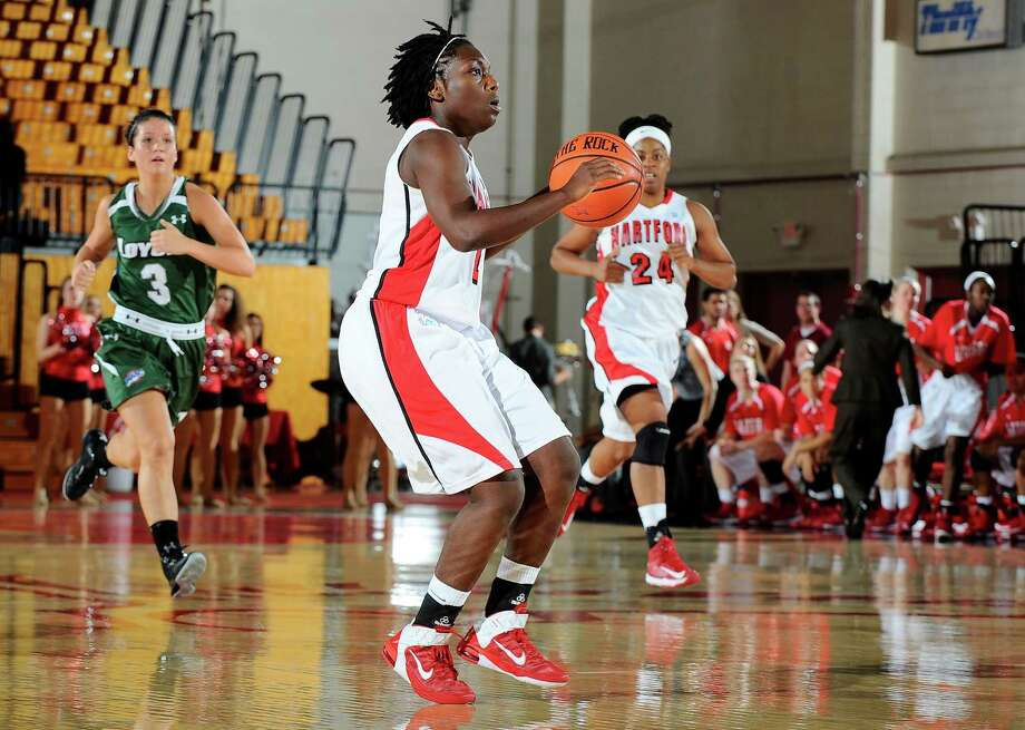 Fairfield-native Daphne Elliott prepares to take a shot during the University of Hartford's 2012-opener against Loyola. Photo: Contributed Photo / STEVE MCLAUGHLIN