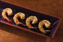 Shrimp in creamy sauce as seen in San Francisco, California, on Wednesday, December 19, 2012. Food styled by Simon F. F. Young.