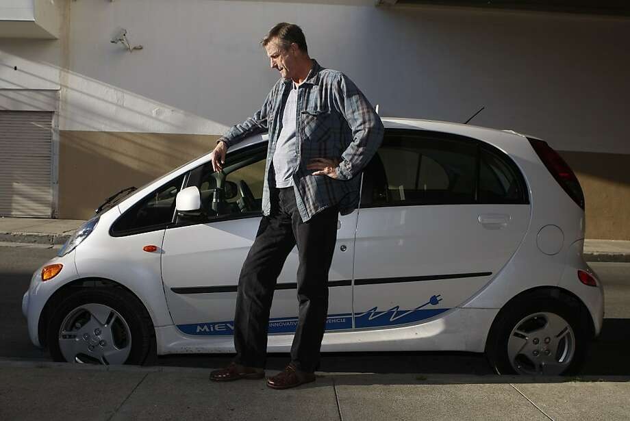 Bill Gravitt of S.F. with his Mitsubishi i-MiEV, a no-frills electric car with a range of roughly 70 miles per charge. Photo: Liz Hafalia, The Chronicle