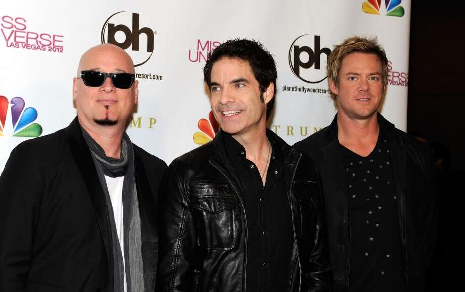 (L-R) Guitarist Jimmy Stafford, singer Pat Monahan and drummer Scott Underwood of the band Train arrive at the 2012 Miss Universe Pageant at Planet Hollywood Resort & Casino on December 19, 2012 in Las Vegas, Nevada.  (Photo by David Becker/Getty Images) (Getty Images)