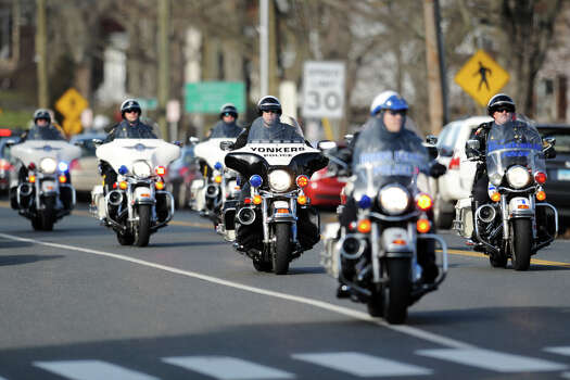 Police motorcycles escort the funeral processing of Jesse McCord Lewis down Main Street, in Newtown, Conn., Dec. 20th, 2012. Lewis is one of twenty students killed in the mass shooting at Sandy Hook Elementary School last Friday. Photo: Ned Gerard / Connecticut Post