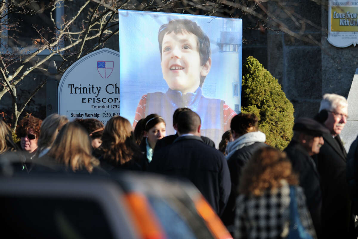 A large banner of Benjamin Wheeler stands in front of Trinity Episcopal Church, in Newtown, Conn. during his funeral service Dec. 20th, 2012. Wheeler is one of twenty students killed in the mass shooting at Sandy Hook Elementary School last Friday.