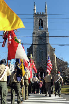 A boy scout color guard arrives for the funeral of Benjamin Wheeler, at Trinity Episcopal Church, in Newtown, Conn., Dec. 20th, 2012. Wheeler is one of twenty students killed in the mass shooting at Sandy Hook Elementary School last Friday. Photo: Ned Gerard / Connecticut Post