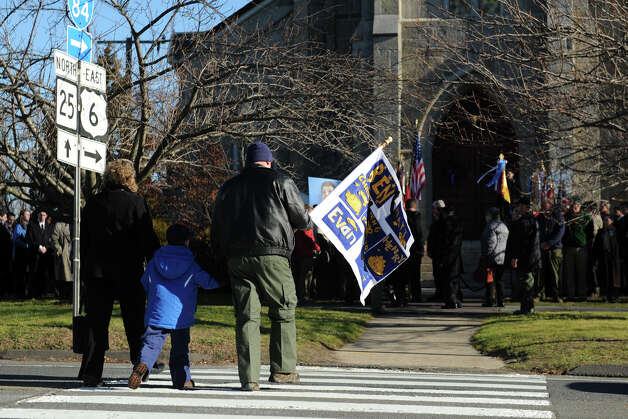 A family arrives for the funeral of Benjamin Wheeler, at Trinity Episcopal Church, in Newtown, Conn., Dec. 20th, 2012. Wheeler is one of twenty students killed in the mass shooting at Sandy Hook Elementary School last Friday. Photo: Ned Gerard / Connecticut Post